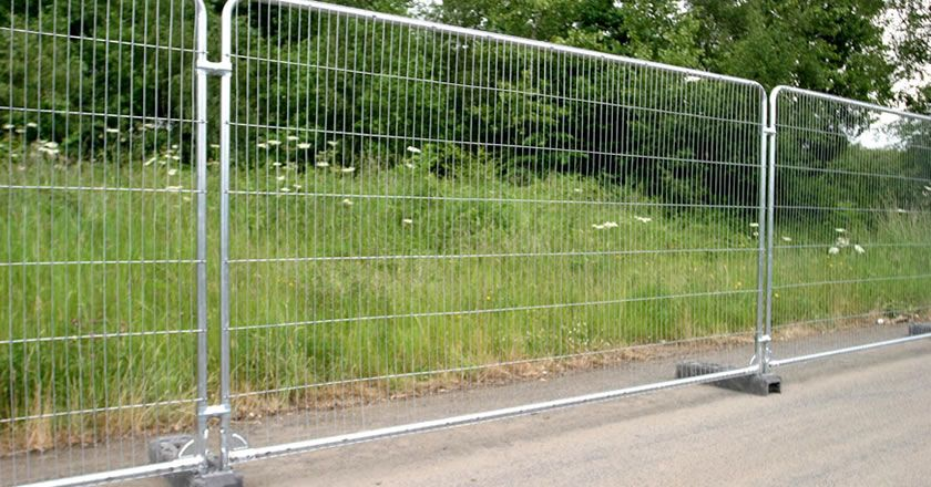 Three panels of Australian temporary fencing is applied on the path beside the grasscluster.