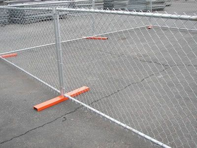 Several chain link portable fence is standing on the orange mental feet.