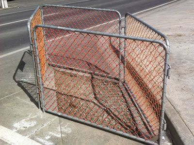 There are four pieces of temporary chain link fences whose inner wire is orange coated.