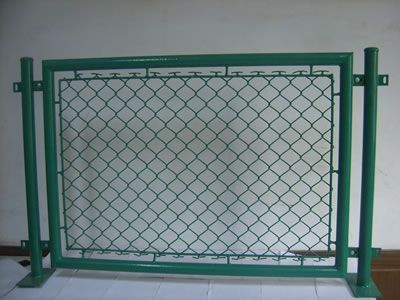 There is a piece of temporary chain link fence with green coated.