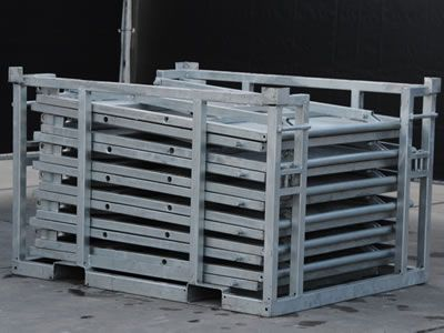 There are several stage barriers packed in a pallet which has two holes on the bottom.
