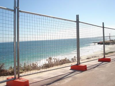 Australian temporary fences are installed by the sea.