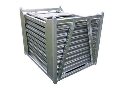 Stage barrier panels are held by a metal trolley.