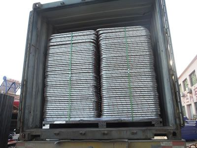 A truck is freighted with chain link portable fences.